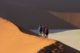 Family Climbing Sand Dune, Namib-Naukluft National Park, Namibia Photographic Print by David Wall