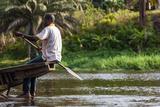Man Rowing Pirogue Boat Down Lobe River, Kribi, Cameroon Photographic Print by Alida Latham