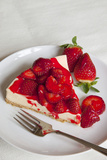 Strawberry Topped Cheesecake on a Round Plate Photographic Print by Brian Jannsen