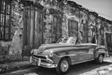 Classic 1953 Chevy Against Worn Stone Wall, Cojimar, Havana, Cuba Photographic Print by Bill Bachmann