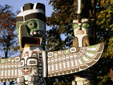Two Totem Poles, Stanley Park, Vancouver, British Columbia, Canada Photographic Print by Walter Bibikow