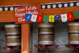 Prayer Wheel and Prayer Flags at Hemis Monastery, Ladakh, India Photographic Print by Ellen Clark