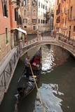 A Gondolier Navigates a Side Canal, Venice, Italy Photographic Print by David Noyes