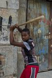 Adolescent Boy Hitting Baseballs in Downtown Street, Havana, Cuba Photographic Print by Bill Bachmann
