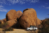 4X4 and Campsite Beside Giant Boulders at Spitzkoppe, Namibia Photographic Print by David Wall
