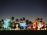 Art Deco Hotels at Dusk, Miami Beach, Florida, USA Photographic Print by Walter Bibikow