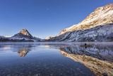 Canoe Glides on Two Medicine Lake, Glacier National Park, Montana, USA Photographic Print by Chuck Haney