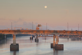 Moonset from the Arkansas River at Dawn, Little Rock, Arkansas, USA Photographic Print by Walter Bibikow