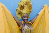 Dancer in Colorful Show Costume Against Blue Wall, Trinidad, Cuba Photographic Print by Bill Bachmann