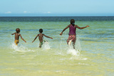 Children Running into the Turquoise Water, Ifaty, Tulear, Madagascar Photographic Print by Anthony Asael