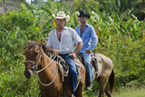 Cowboys on Horses Riding on Road from Ranch, Trinidad, Cuba Photographic Print by Bill Bachmann