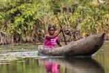 Woman Rowing Traditional Pirogue Down Du River, Monrovia, Liberia Photographic Print by Alida Latham