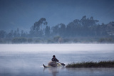 Otavalo Indian Fisherman in Reed Boat, Lake San Pablo, Andes, Ecuador Photographic Print by Pete Oxford