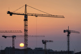 Construction Cranes at Sunrise, Cherbourg-Octeville, Normandy, France Photographic Print by Walter Bibikow