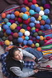Women Weaving Next to Pile of Yarn Balls, Chinchero, Peru Papier Photo par John & Lisa Merrill