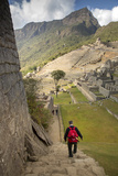 Man Walking Down Stone Steps of Machu Picchu, Peru Photographic Print by John & Lisa Merrill