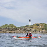Sea Kayaker and Lighthouse, Destruction Island, Washington, USA Photographic Print by Gary Luhm