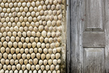Cowrie Shells on Wall of Building, Ibo Island, Morocco Photographic Print by Alida Latham