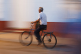 Man in Motion Riding Bicycle at Night, Trinidad, Cuba Photographic Print by Adam Jones