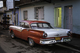 1950's Era Ford Fairlane and Colorful Buildings, Trinidad, Cuba Photographic Print by Adam Jones