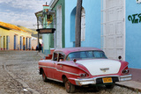 Colorful Buildings and 1958 Chevrolet Biscayne, Trinidad, Cuba Photographic Print by Adam Jones
