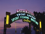 Santa Monica Pier Neon Entrance Sign, Los Angeles, California, USA Photographic Print by Walter Bibikow