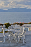 Table and Chairs on Patio in Front of Aegean Sea from Kusadasi, Turkey Photographic Print by Darrell Gulin