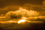 Sun Rising Through the Clouds at Dawn, ANWR, Alaska, USA Photographic Print by Steve Kazlowski