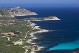 Elevated View of Punta Revellata Lighthouse, Calvi, Corsica, France Photographic Print by Walter Bibikow