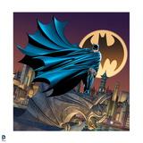 Batman: Batman Standing on a Gargoil Cape Wrapped around Him City and a Bat Signal Behind Him Posters