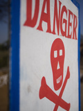 Skull and Crossbones Danger Sign, Udaipur, Rajasthan, India Photographic Print by David H. Wells