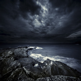 Black Rocks Protruding Through Rough Seas with Stormy Clouds, Crete, Greece Photographic Print