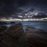 Huge Rocks on the Shore of a Sea Against Stormy Clouds, Sardinia, Italy Photographic Print