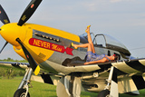 1940's Style Pin-Up Girl Lying on the Wing of a P-51 Mustang Fotoprint