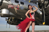 Beautiful 1940's Style Pin-Up Girl Standing under a B-17 Bomber Photographic Print