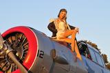 1940's Style Aviator Pin-Up Girl Posing with a Vintage T-6 Texan Aircraft - Fotografik Baskı