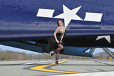 1940's Style Pin-Up Girl in Cocktail Dress Posing in Front of a Tbm Avenger Fotografiskt tryck