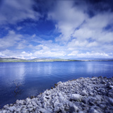 Tranquil Lake and Rocky Shore Against Cloudy Sky, Sardinia, Italy Photographic Print