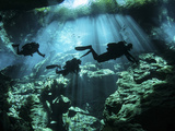 Diver Enters the Cavern System in the Riviera Maya Area of Mexico Fotografie-Druck
