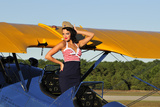 Patriotic Pin-Up Girl Standing Inside the Cockpit of a Stearman Biplane Photographic Print