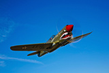 A Curtiss P-40E Warhawk in Flight Near Chino, California Photographic Print