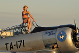 1940's Style Pin-Up Girl Sitting on the Cockpit of a World War II T-6 Texan Fotoprint