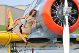 1940's Style Pin-Up Girl Posing on a T-6 Texan Training Aircraft Fotoprint