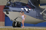 Retro Pin-Up Girl Posing with a World War II Era Pby Catalina Seaplane Photographic Print