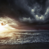 Bright Sunset Against a Wavy Sea with Stormy Clouds, Hersonissos, Crete Photographic Print