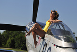 Retro Pin-Up Girl Sitting Outside the Cockpit of a P-51 Mustang Stampa fotografica