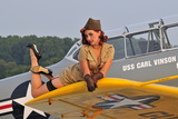 1940's Style Pin-Up Girl Lying on a T-6 Texan Training Aircraft Fotografická reprodukce