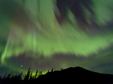 Aurora Borealis over Mountain, Marsh Lake, Yukon, Canada Photographic Print