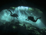 Two Divers Silhouetted in Light at Entrance to Chac Mool Cenote, Mexico Photographic Print