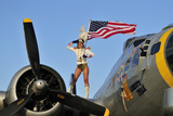 1940's Style Majorette Pin-Up Girl on a B-17 Bomber with an American Flag Fotografiskt tryck
